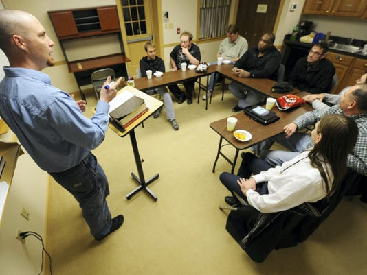 """Titus Conley leads a Nazarene group called the """"Man Cave"""" in a discussion onday about manhood at the Sprenkle House."""