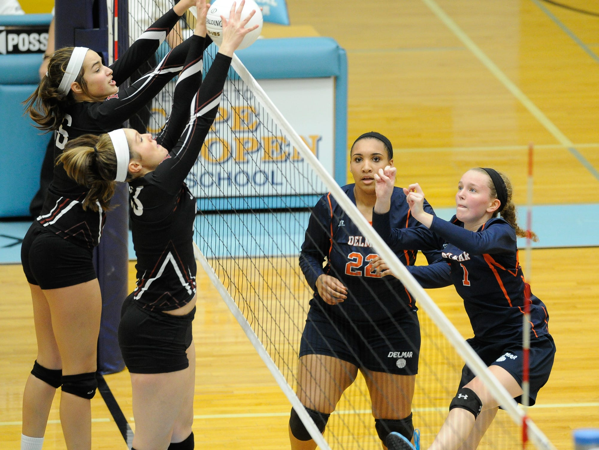 Delmas's #1 Samantha Lehman with a spike in their game against Appoquinimink, Thursday night at Cape Henlopen High School.