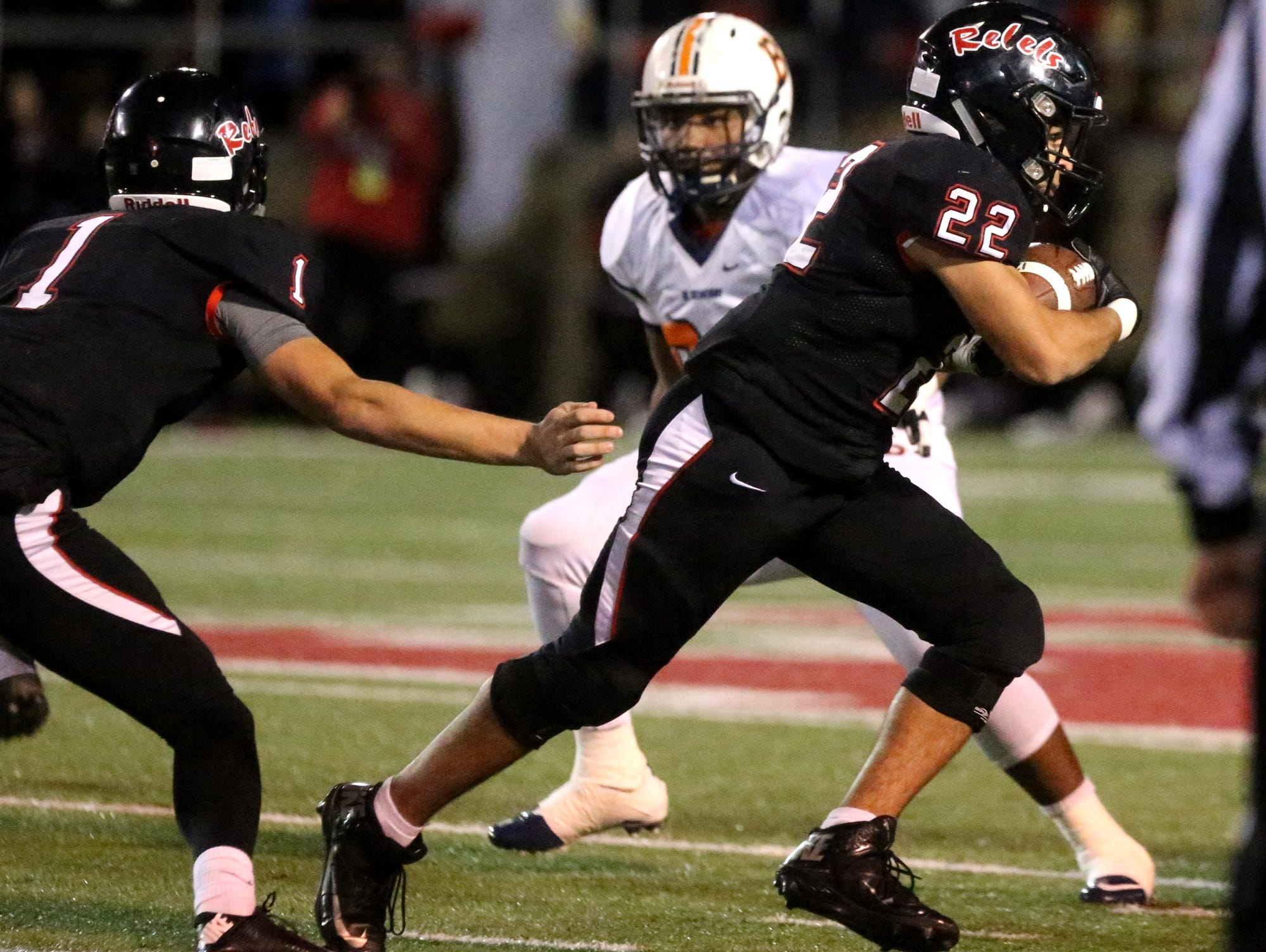 Maryville's Jordan Ervin (22) runs the ball after Maryville's quarterback Dylan Hopkins hands the ball off to Ervin during the quarterfinal game against Blackman, at Maryville, on Friday, Nov. 20, 2015.