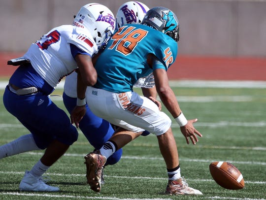 Players go after an Irvin fumble Thursday. Pebble Hills