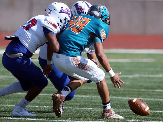 Players go after an Irvin fumble Thursday. Pebble Hills recovered and converted it into a touchdown.