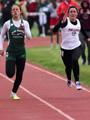 Oak Harbor's Sophia Eli, left, and Port Clinton's Abbey Weldon qualified to regionals as part of a 4x100 relays.