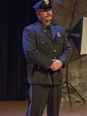 Officer Mark Gehron at a 2013 awards ceremony. The