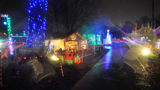 Despite the rain, visitors tour around the many Christmas lights and Nativity scenes Wednesday night at the Rotary Winter Wonderland in Marshfield.