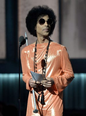 Prince, seen here at the 57th annual Grammy Awards in Los Angeles in  2015, had pills at his estate which were counterfeit, according to reports.
