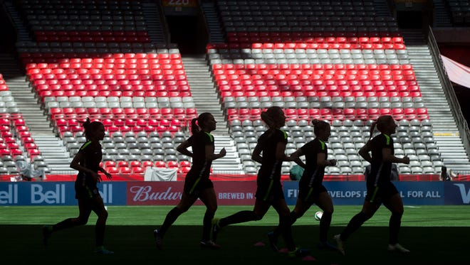 United States players are silhouetted as they jog during FIFA Women's World Cup soccer practice in Vancouver, British Columbia, Canada, on Saturday, July 4, 2015. The U.S. and Japan are scheduled to play in the final on Sunday in Vancouver.