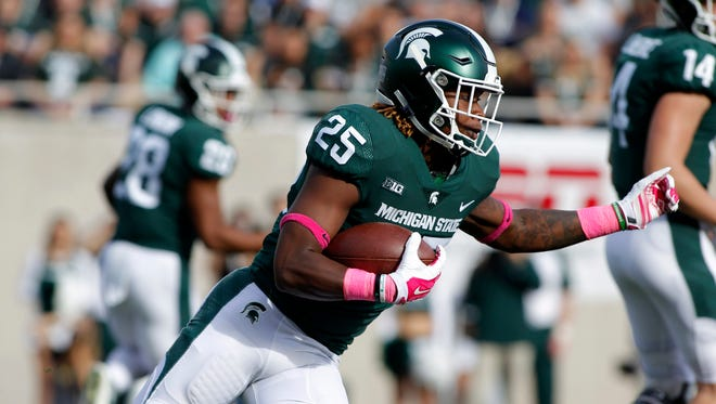 Michigan State's Darrell Stewart rushes against Indiana during the first quarter.