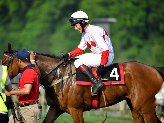 Jockey Ross Geraghty is all smiles after riding Zanjabeel to win the 77th Iroquois Steeplechase at Percy Warner Park on May 12, 2018.