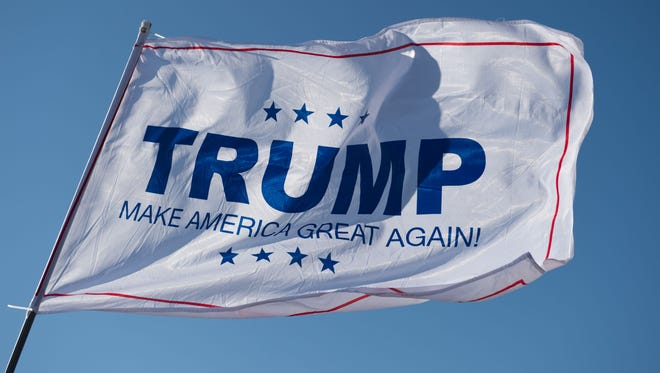 A Donald Trump campaign flag waves outside a Trump rally at Millington Regional Jetport on Feb. 27, 2016, in Millington, Tennessee.