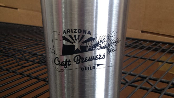 Ten of these Arizona Craft Brewers Guild stainless steel growlers will be given away at eight breweries around metro Phoenix tonight at midnight in celebration of a new growler law.