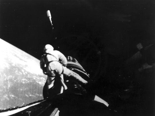 Astronaut Richard F. Gordon is pictured during a space walk outside the Gemini 11 space capsule. Left, a section of the Earth can be seen, September 13, 1966.
