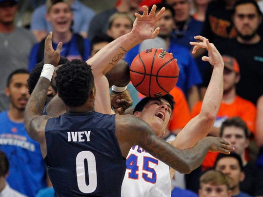 Texas-Arlington Mavericks forward Jorge Bilbao (45) and Akron Zips guard Jimond Ivey (0) battle for a loose ball under the net in the first half of an NCAA college basketball game in the NIT, Monday, March 20, 2017, in Arlington, Texas. (Paul Moseley/Star-Telegram via AP)
