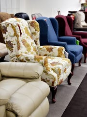 Furniture, such as armchairs, is shown  at Bon-Ton's furniture gallery in the Queensgate Shopping Center in York Township.