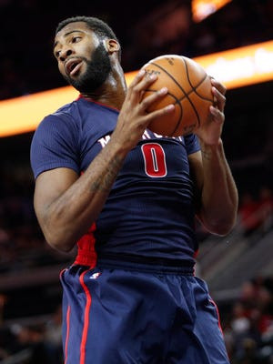 Pistons center Andre Drummond (0) gets a rebound during the first quarter Sunday at the Palace.