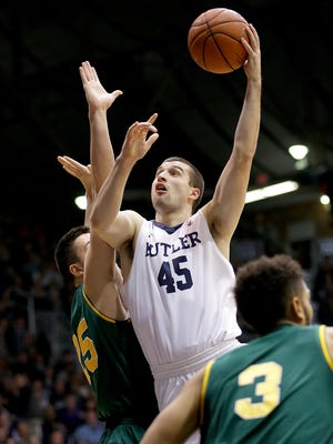 Butler Bulldogs forward Andrew Chrabascz (45) shoots over Vermont Catamounts forward Drew Urquhart (25) in the first half of their game Wednesday, December 21, 2016, evening at Hinkle Fieldhouse.
