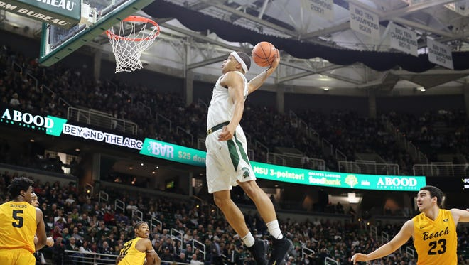 Michigan State's Miles Bridges dunks during the game against Long Beach State on Dec. 21, 2017, at Breslin Center.