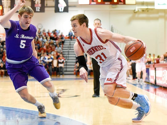 St. John's University's Patrick Strom take the ball