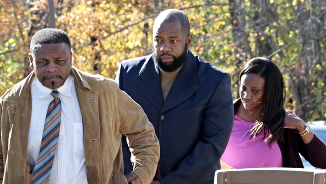 Tyrone Mushatt, center, former Westchester Community College men's basketball coach, arrives at Mount Pleasant Town Court for arraignment on Oct. 29, 2015. He was accused of using bogus transcripts to help star players earn NCAA Division I scholarships.