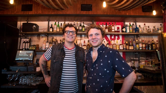 Northside Yacht Club owners Jon Weiner and Stuart Mackenzie behind the bar on opening night Friday.