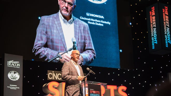 Dr. Tim Kremchek of Beacon Orthopedics presents the Courage Award at the 2017 Cincinnati.com Sports Awards at the Aronoff Center on Monday May 22, 2017. Phil Didion for The Enquirer.