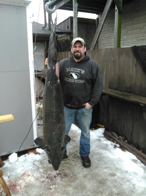 John Epprecht of Oshkosh brought in the largest sturgeon on Tuesday.