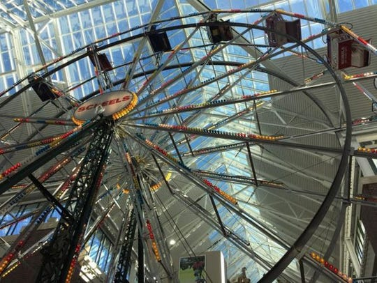 The Ferris wheel takes passengers for a ride inside the Scheel's sporting goods store in Sparks.