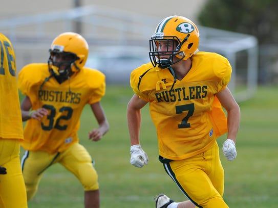 Patrick McAllister, a CMR senior football player, runs