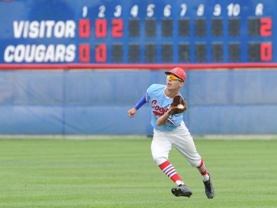 Cooper center fielder Jared Rodriguez hauls in Jacob