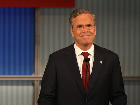 Republican presidential candidate Jeb Bush smiles during the Republican Presidential Debate sponsored by Fox Business and the Wall Street Journal at the Milwaukee Theatre November 10, 2015 in Milwaukee, Wisconsin.