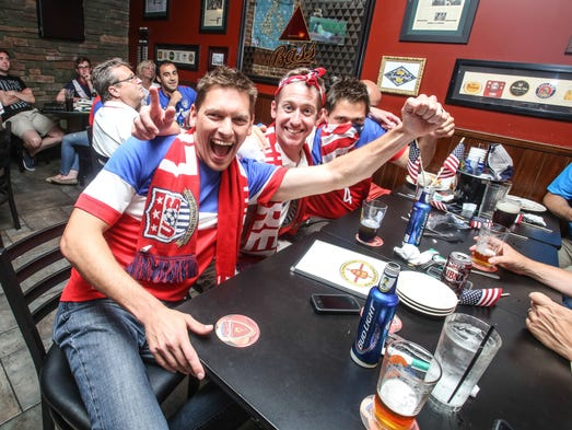 Monday June 16th, 2014, Chad Hazelrigg (left), and Nate Luepke (center), and Charlie Fuhrer (right), watch the U.S.A. V.S. Ghana, in The World Cup, at Chatham Tap in Fishers Indiana.
