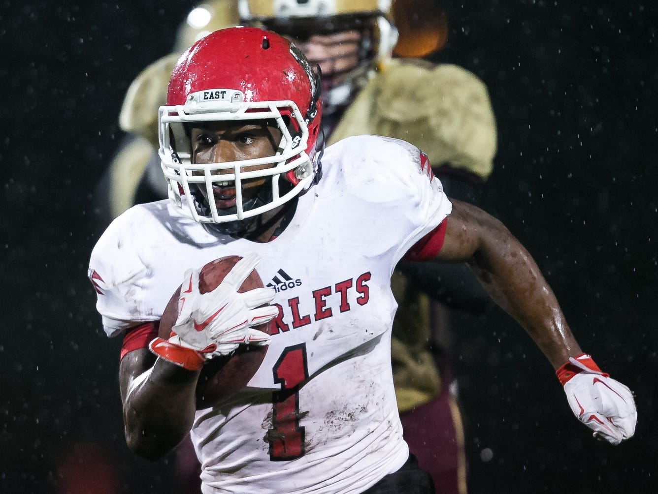 East High's Brandon Trotter rushes during their game against Lincoln at Lincoln High School in Des Moines on Friday, September 18, 2015.