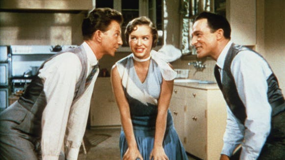 Donald O'Connor as Cosmo Brown, Debbie Reynolds as