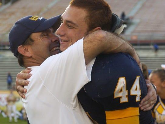 Naples head coach Bill Kramer gives Layne McCombs a