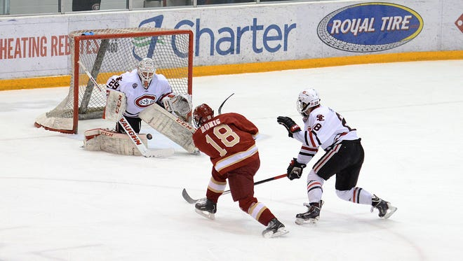 St. Cloud State's Ryan Faragher (29) defends against Denver's Emil Romig (18) during a game last season at the Herb Brooks National Hockey Center.