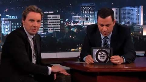 Jimmy Kimmel holds a photo of Dax Shepard's 'World's Worst Wedding' cake on Monday's late-night ABC show.