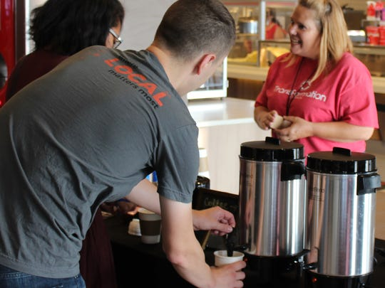 But first ... coffee. There were no doughnuts but filling cups with hot coffee was a popular way to start worship Sunday at Transformation Church, which meets at the new Abilene Cinemark.