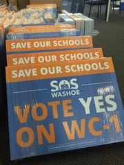 Save Our Schools campaign signs are stacked on the floor at campaign headquarters in Downtown Reno