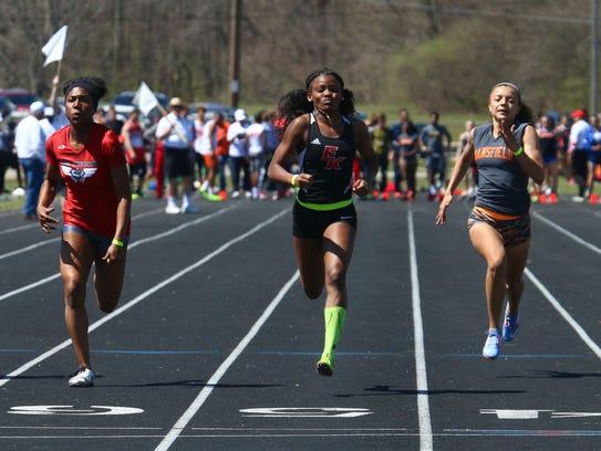 East Kentwood's Sekayi Bracey wins the 100 meter dash,
