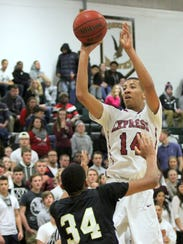 Elmira's Jadakis Brooks takes a shot against Corning