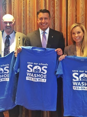 Left to right: Sparks Mayor Geno Martini, Gov. Brian Sandoval and Reno Mayor Hillary Schieve endorse the Washoe County sales tax increase for public schools on Thursday, Aug. 18.