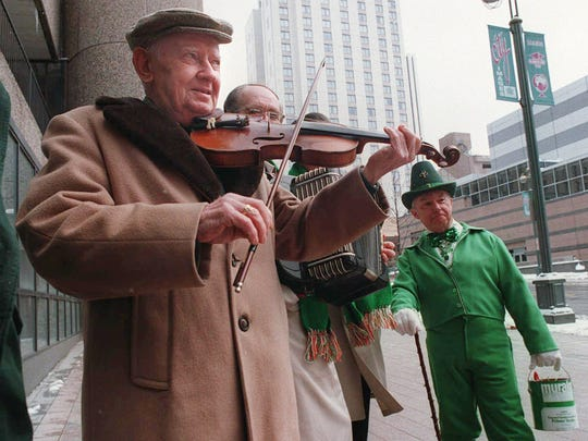 Marty O'Keefe plays the fiddle as part of a promotion for the St. Patrick's Day Parade in 1995.
