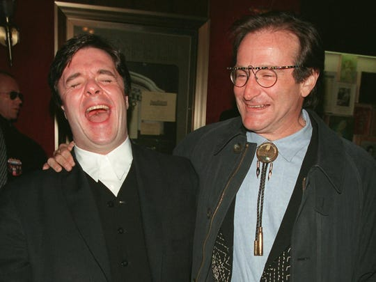 "Nathan Lane (left) and Robin Williams arrive at a gala New York screening of ""The Birdcage"" March 3, 1996."