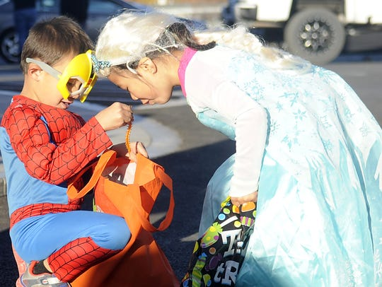 Carliegh Metibo, 4, peers into the candy sack belonging