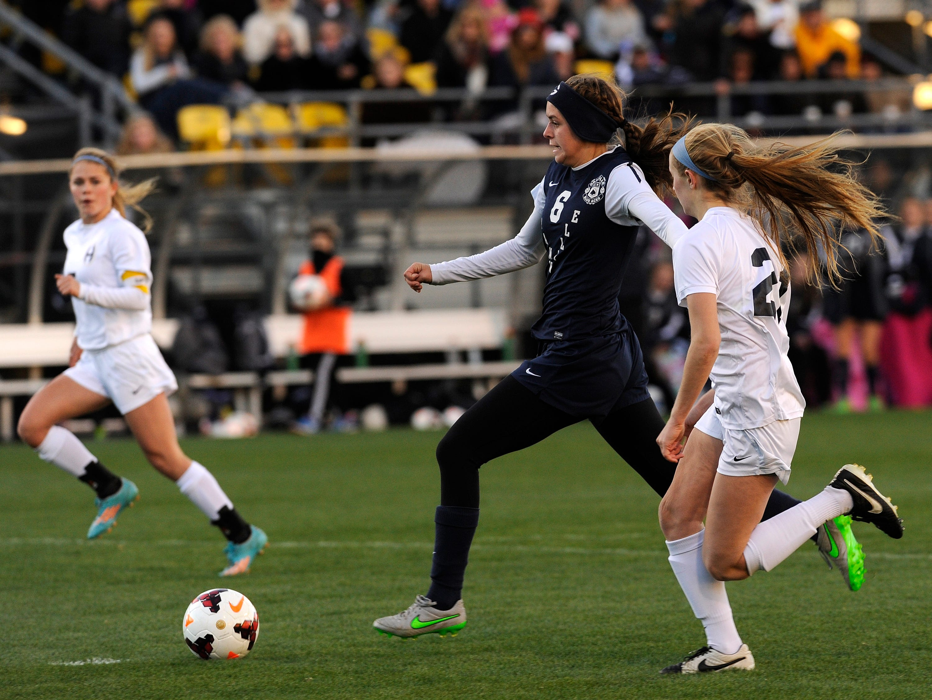 Granville senior forward Rose Sawyers outruns Akron Hoban defender Olivia Petit to take a shot on goal. Sawyers scored the Blue Aces lone goal in the first half of the state final game. The Blue Aces fell 2-1 in overtime in the state final on Friday, Nov. 13, 2015, at Mapfre Stadium in Columbus.