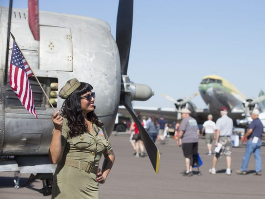At left, pinup model Lily Keith of Maricopa poses for