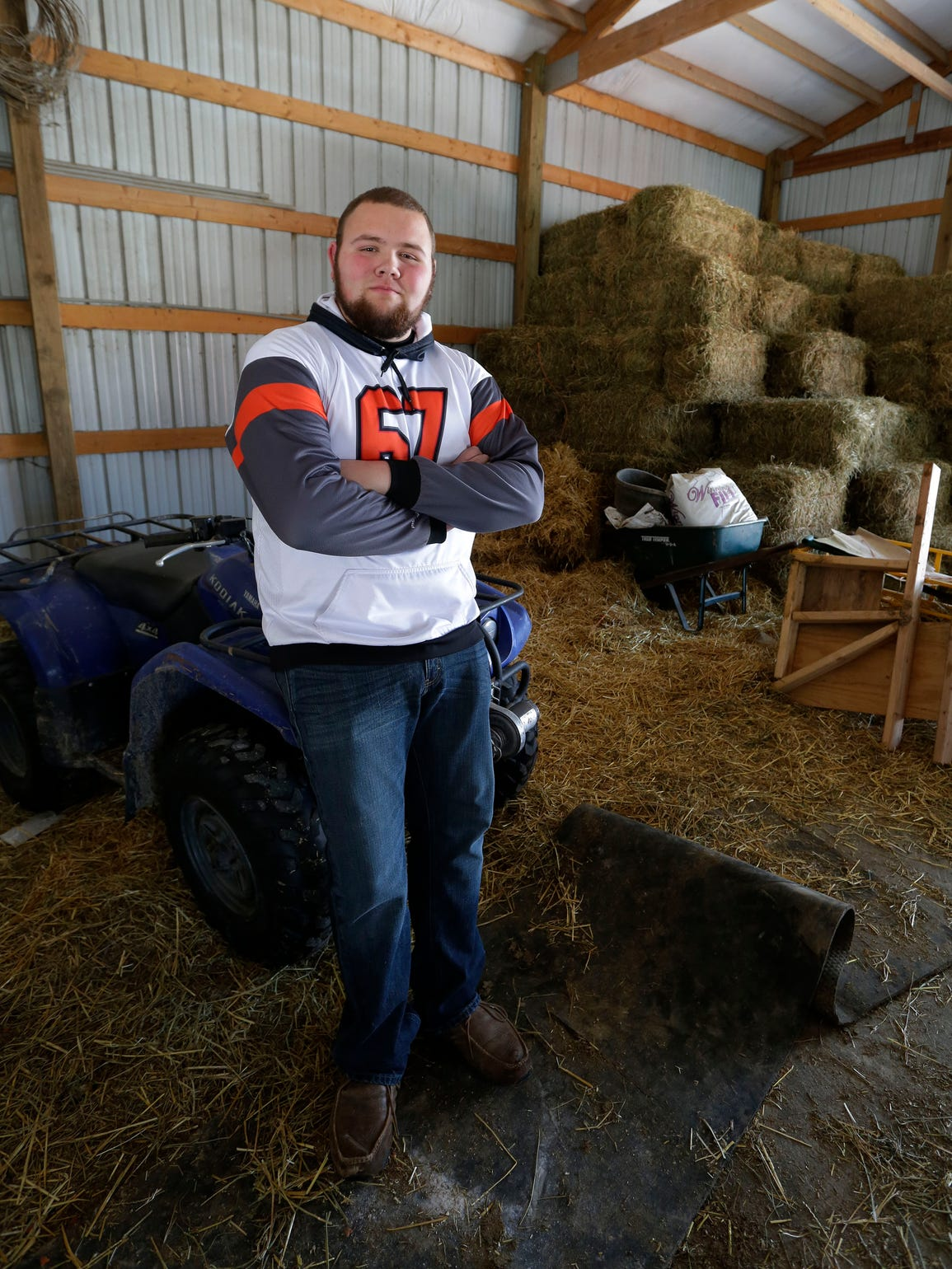 Bryce Ladwig poses in his barn, Thursday, April 19,