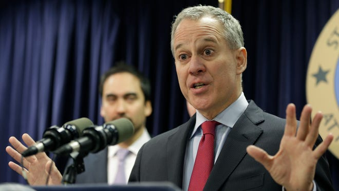 "FILE - In this March 21, 2016, file photo, New York Attorney General Eric Schneiderman speaks during a news conference in New York. Schneiderman says his colleagues and other lawyers are being moved to action because they believe Trump ""does not have respect for the rule of law."" (AP Photo/Seth Wenig, File)"