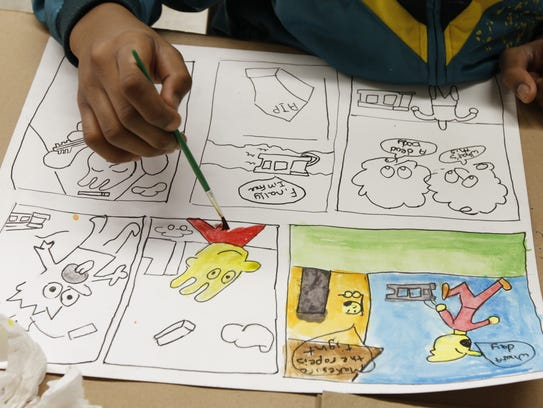 A student does cartooning during a past workshop at