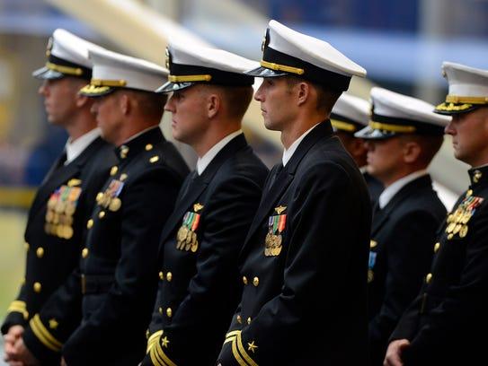 Squadron members listen as Capt. Ryan Bernacchi, outgoing