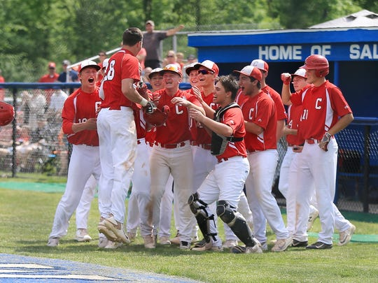 All was good for a while Saturday for Canton. Here, the Chiefs mob sophomore Aaron Dolney (28) after he hit a tie-breaking home run in the fourth against Plymouth.
